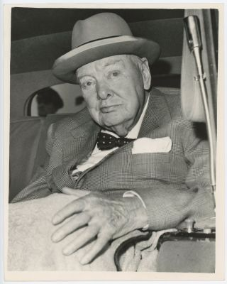 An original press photo of Sir Winston S. Churchill after arrival at London Airport on 4...