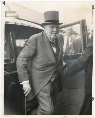 An original press photo of Sir Winston S. Churchill arriving at Epsom Downs to attend the horse...