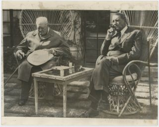 An original press photo of Sir Winston S. Churchill and former French President René Coty on 5...