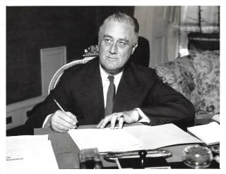 An original press photo of President Franklin Delano Roosevelt on 8 June 1936 at the White House...