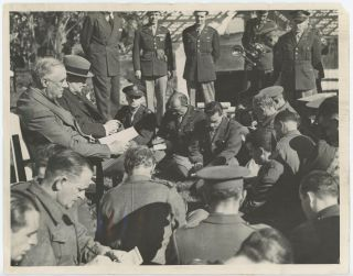 An original wartime press photograph of Prime Minister Winston S. Churchill and President...