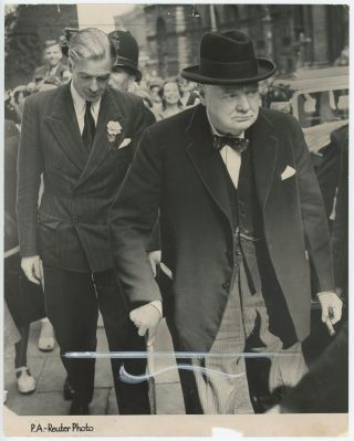 GRAVE FACES IN DOWNING STREET - an original press photograph of Winston S. Churchill and Anthony...