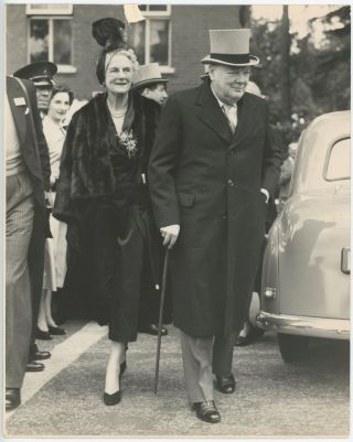 An original press photograph of Winston S. Churchill and his wife, Clementine, arriving at Ascot...