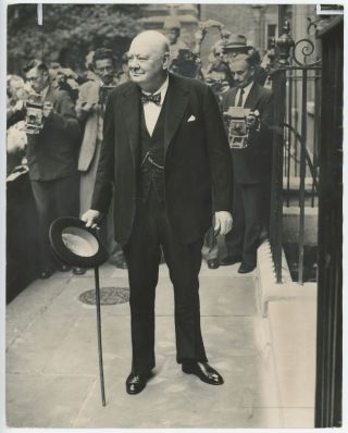 An original press photo of Prime Minister Sir Winston S. Churchill in front of a battery of...
