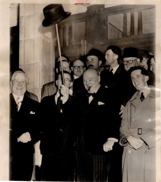 An original press photograph of Winston S. Churchill on 2 October 1951 holding his hat aloft on...