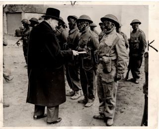 An April 1942 Second World War press photograph featuring Prime Minister Winston S. Churchill...