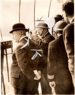 A wartime press photograph of British Prime Minister Winston S. Churchill, accompanied by his...