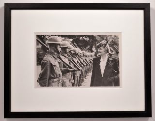 A truly striking original Second World War press photograph of Prime Minister Winston S. Churchill's wife, Clementine, inspecting the Home Guard of the Port of London on 22 July 1941